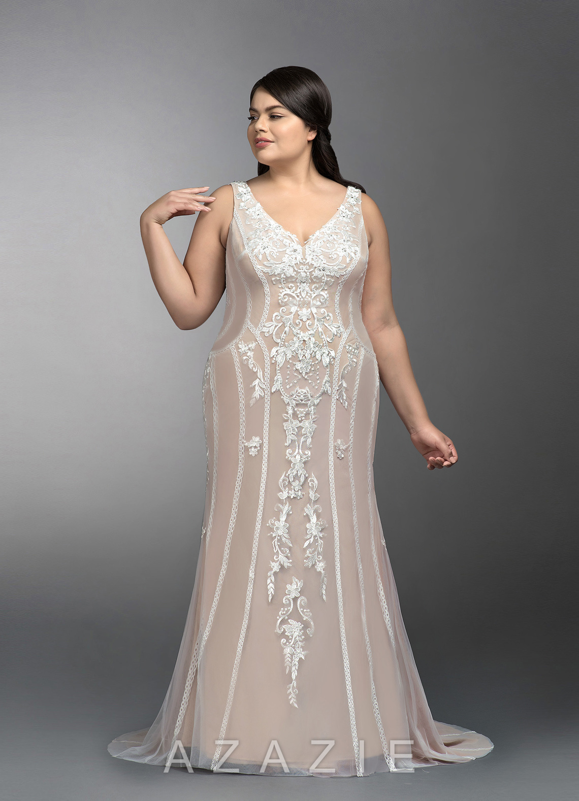 A sleeveless full length wedding dress